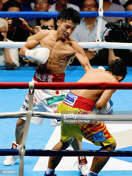 Champion Naoya Inoue of Japan punches Samartlek Kokietgym of Thailand in the fourth round during their WBC light flyweight title bout at Yoyogi Daini...