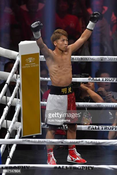 Champion Naoya Inoue of Japan raises his hands after winning against challenger Juan Carlos Payano of the Dominican Republic during the WBA...