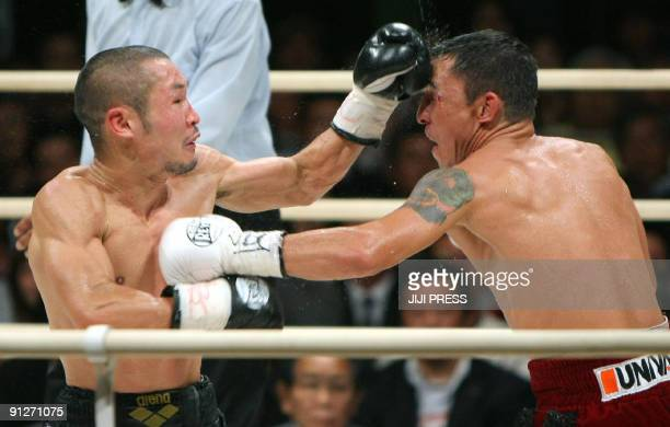 Champion Nobuo Nashiro of Japan and Mexican challenger Hugo Cazares trade blows during the WBA super flyweight title match in Osaka western Japan on...