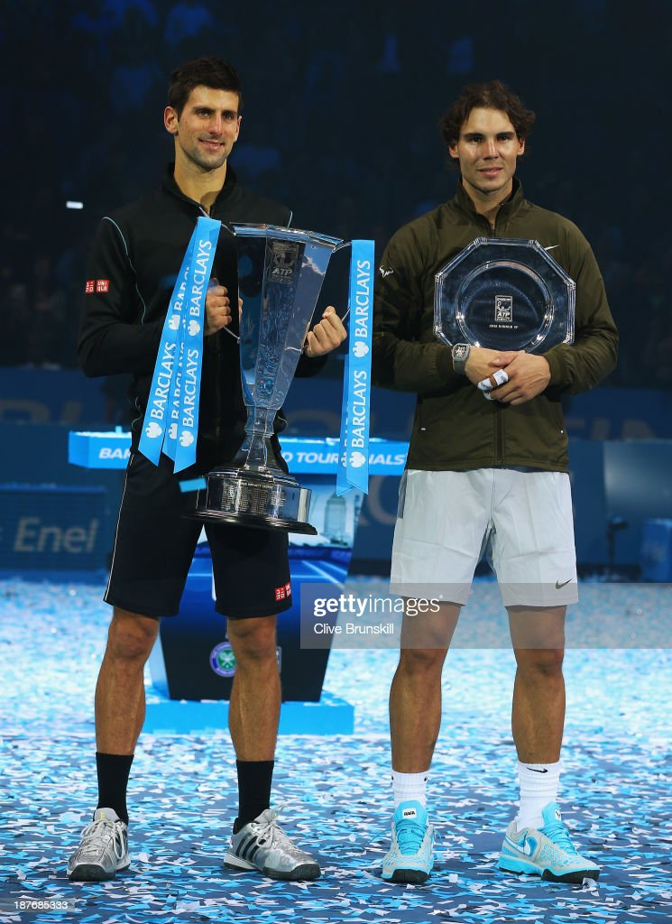 Champion Novak Djokovic (L) of Serbia and Rafael Nadal of Spain pose with their trophies after their men's singles final match during day eight of the Barclays ATP World Tour Finals at O2 Arena on November 11, 2013 in London, England.