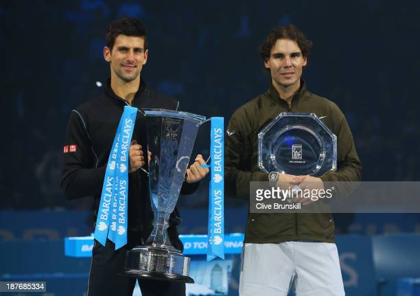 Champion Novak Djokovic of Serbia and Rafael Nadal of Spain pose with their trophies after their men's singles final match during day eight of the...