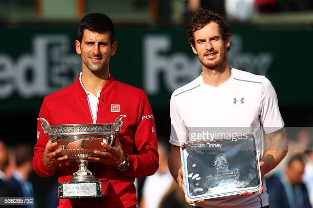 Champion Novak Djokovic of Serbia and runner up Andy Murray of Great Britain pose with the trophies won during the Men's Singles final match on day...