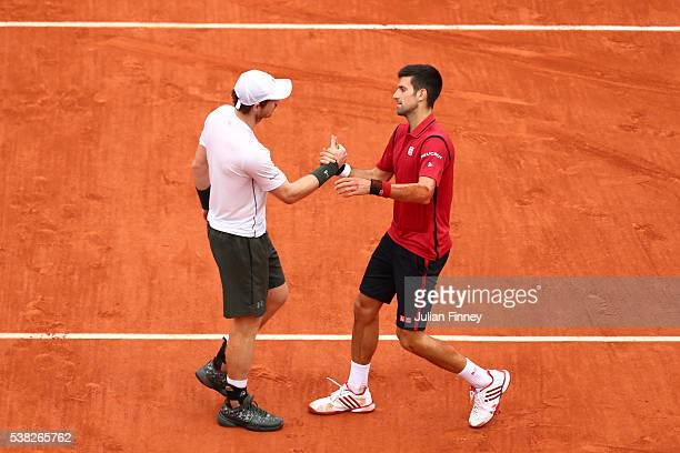 Champion Novak Djokovic of Serbia and runner up Andy Murray of Great Britain shake hands following the Men's Singles final match on day fifteen of...