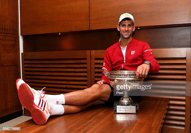 Champion Novak Djokovic of Serbia celebrates following his victory during the Men's Singles final match against Andy Murray of Great Britain on day...