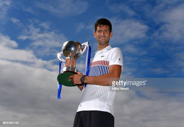 Champion Novak Djokovic of Serbia poses with the trophy after victory in the mens singles final against Gael Monfils of France on day seven of the...