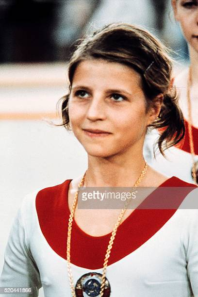 USSR champion Olga Korbut aged 15 poses on the Olympic Gymnastics individual event podium on September 01 1972 in Munich where she captured four gold...