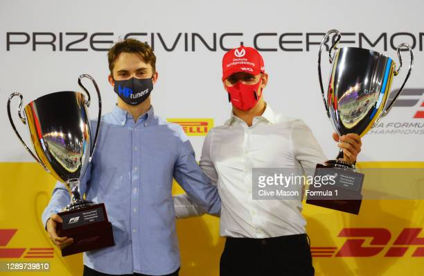 Champion Oscar Piastri of Australia and Prema Racing and 2020 F2 Champion Mick Schumacher of Germany and Prema Racing celebrate during the Formula 2...