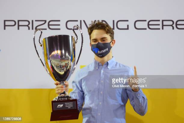 Champion Oscar Piastri of Australia and Prema Racing is presented with his trophy during the Formula 3 Championship Prize Giving Ceremony at Bahrain...