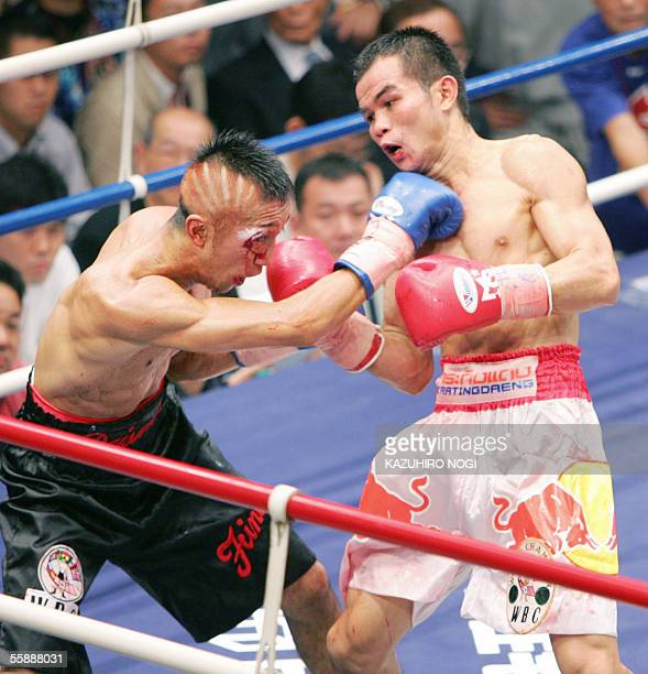 Champion Pongsaklek Wonjongkam of Thailand gives a right uppercut to the head of Japanese challenger Daisuke Naito during the WBC flyweight title...