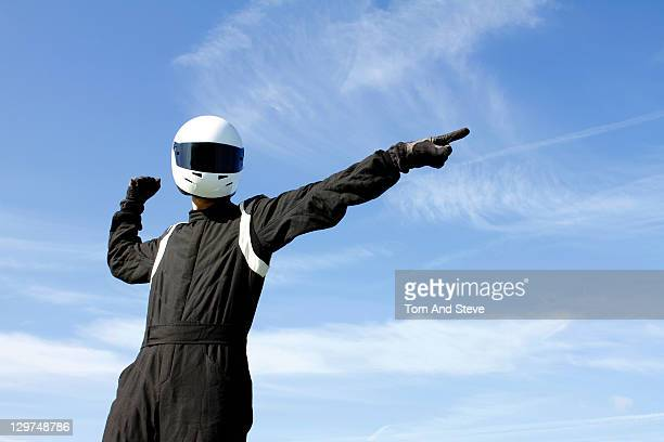 Champion racing driver strikes a winning pose