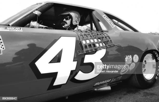 NASCAR champion Richard Petty sits behind the wheel of his No 43 race car prior to the start of the 1980 Daytona 500 stock car race at Daytona...