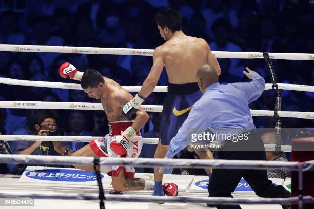 Champion Ryota Murata of Japan knocks down challenger Emanuele Blandamura of Italy during the WBA Middleweight Title Bout at Yokohama Arena on April...