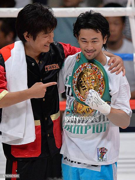 Champion Shinsuke Yamanaka of Japan celebrates with the belt after defeating Challenger Jose Nieves of Puerto Rico during their WBC Bantamweight...