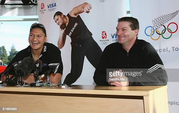 Champion shot putter Valerie Vili talks to the media with her manager Nick Cowan during a press conference at the Mitsubishi Motors showroom on July...