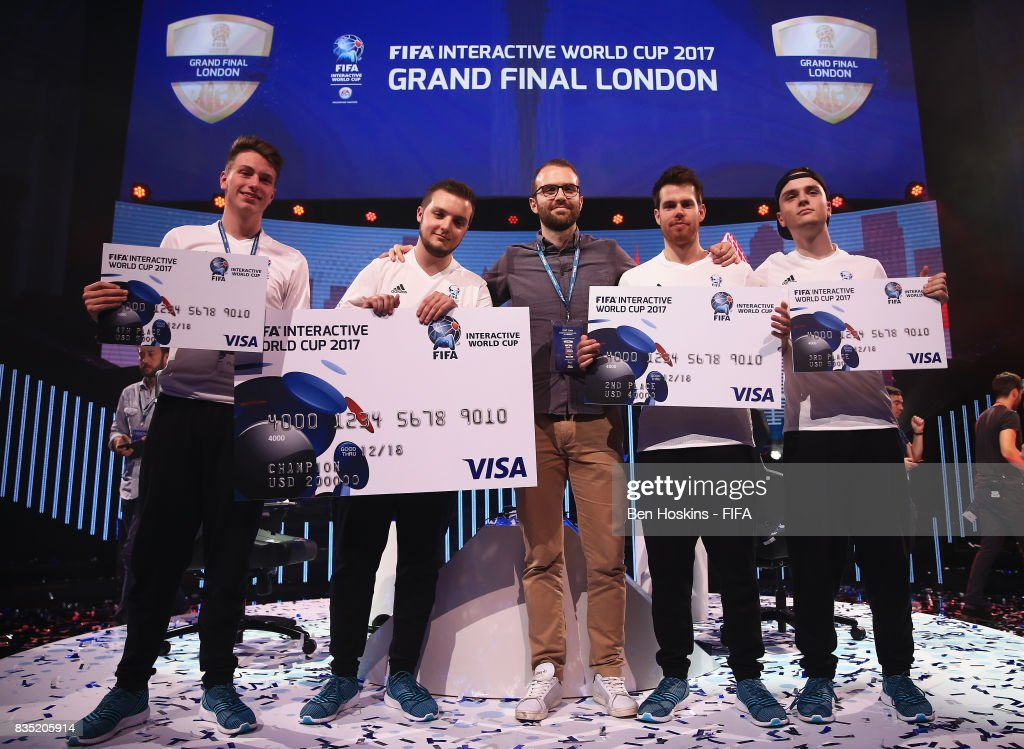 Champion Spencer 'Gorilla' Ealing (2ndL) of England poses with Timo 'Timox' Siep (L) of Germany, Alexander Shapiro (C) of Visa, Kai 'Deto' Wollin of Germany and Florian 'Codyderfinisher' Muller (R) of Germany after the final during day three of the FIFA Interactive World Cup 2017 Grand Final at Central Hall Westminster on August 18, 2017 in London, England.