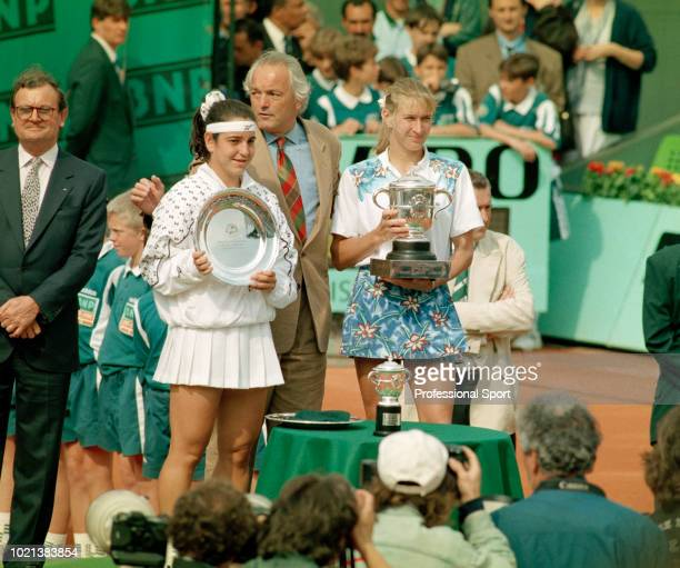 Champion Steffi Graf of Germany and runnerup Arantxa Sanchez Vicario of Spain pose with their trophies after Graf wins the Women's Singles Final of...