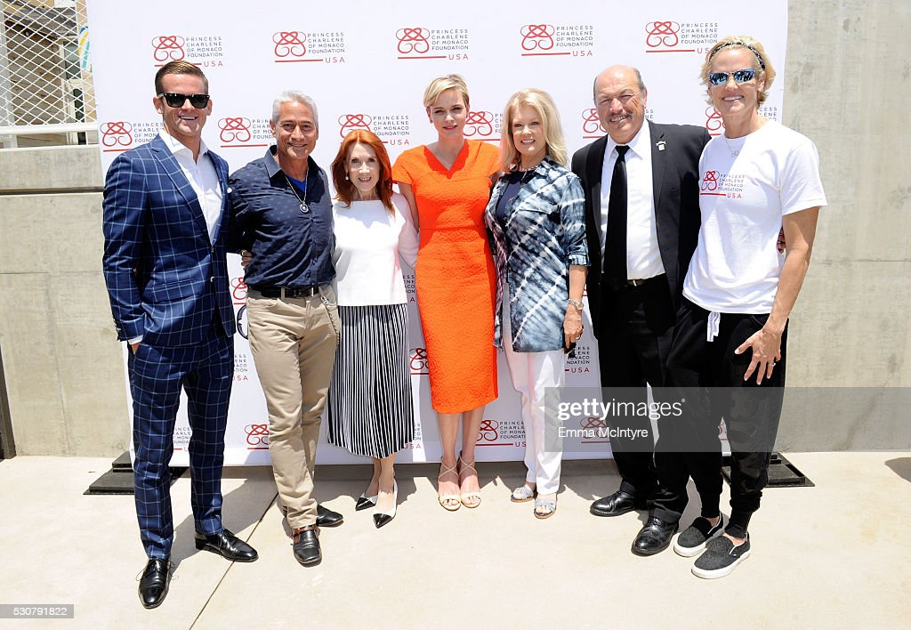 U.S. Champion Surfer and Princess Charlene of Monaco Foundation Ambassador - Monaco, Nic Lamb, U.S. Olympic Diver, Greg Louganis, Editor, novelist and philanthropist, Linda Bruckheimer, Founder, Princess Charlene of Monaco Foundation, Princess Charlene of Monaco, tv personality Mary Hart, City of Santa Monica Mayor Tony Vazquez and U.S. Olympic Swimmer, Dara Torres attend The Princess Charlene of Monaco Foundation-USA Official Launch at the Annenberg Community Beach House on May 12, 2016 in Santa Monica, California.