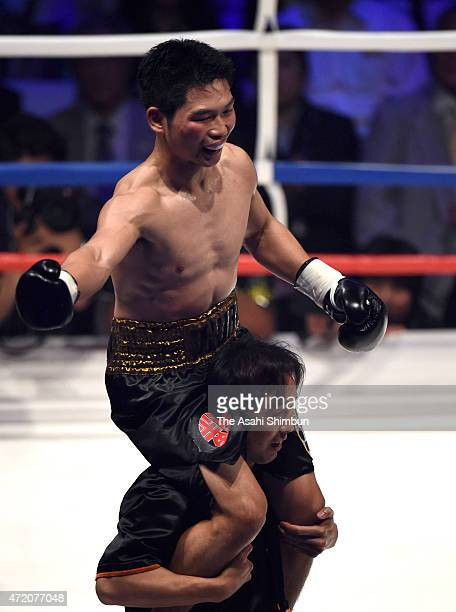 Champion Takashi Miura of Japan celebrates defending his title against Billy Dib of Australia after their WBC world super featherweight title bout at...