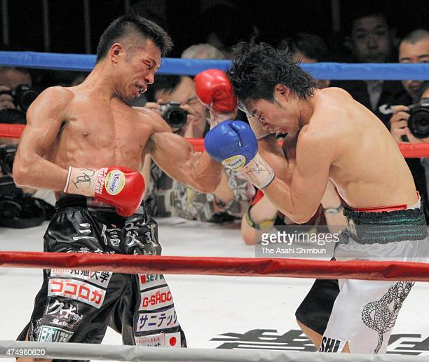 Champion Takashi Uchiyama of Japan hits his left uppercut on challenger Takashi Miura during their WBA Super Featherweight title bout at Ariake...