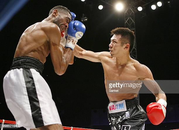 Champion Takashi Uchiyama of Japan hits his right on challenger Angel Granados of Venezuela during the WBA Super Featherweight Title Fight at Saitama...