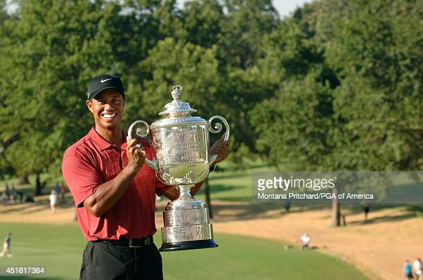 Champion Tiger Woods posing with the Wanamaker trophy on 18 green after the Final Round of the 89th PGA Championship held at Southern Hills Country...