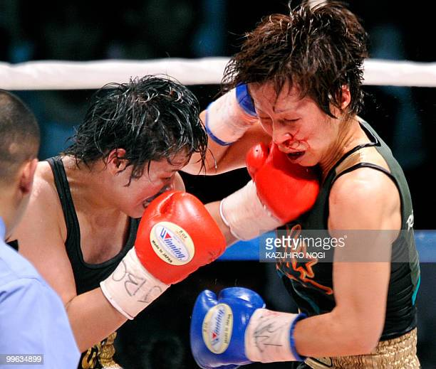 Champion Tsunami Tenkai of Japan connects with her left against challenger Kayoko Ebata of Japan during their WBA women's super flyweight title...