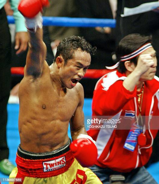 Champion Veeraphol Nakhonluang of Thailand punches his fist into the air after retaining the championship belt after his WBC bantamweight title match...