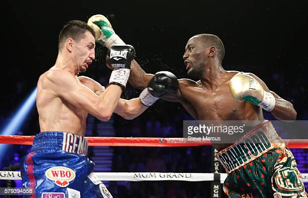 WBC champion Viktor Postol of Ukraine gets hit by WBO junior welterweight champion Terence Crawford during their title unification fight at MGM Grand...
