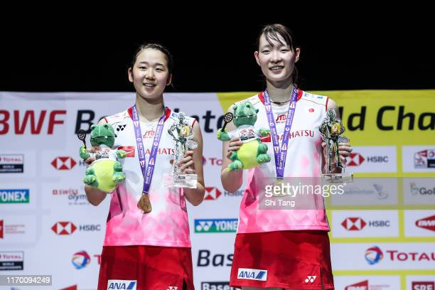 Champion Wakana Nagahara and Mayu Matsumoto of Japan pose with their medals on the podium for the women's doubles event during day seven of the Total...