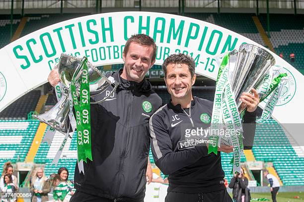 Champions Celtic manager Ronny Deila and assistant John Collins with the League cup lift the trophy after the Scottish Premiership Match between...