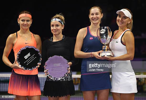 Champions Ekaterina Makarova and Elena Vesnina of Russia pose with Bethanie MattekSands of the United States and Lucie Safarova of Czech Republic...