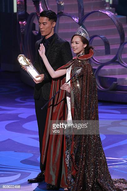 Champions Jackson Lai and Crystal Fung pose during the Mr and Miss Hong Kong Pageants 2016 at TVB City on September 11 2016 in Hong Kong China