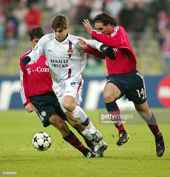 Champions League 03/04, Muenchen; FC Bayern Muenchen - Olympique Lyon 1:2; Martin DEMICHELIS/Bayern, JUNINHO/Lyon, Claudio PIZARRO/Bayern