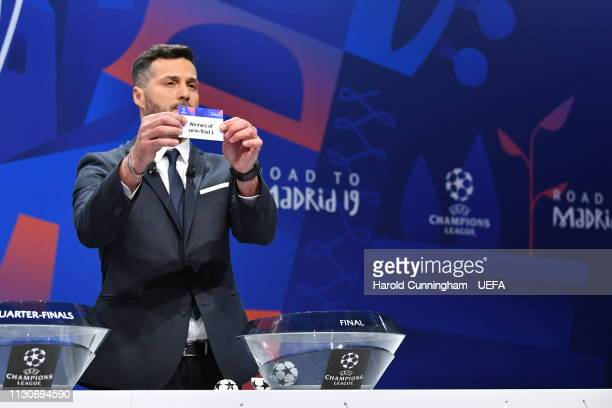 Champions League ambassador Julio Cesar draws out the card of 'Winners of semifinal 1' during the UEFA Champions League 2018/19 Quarterfinal...