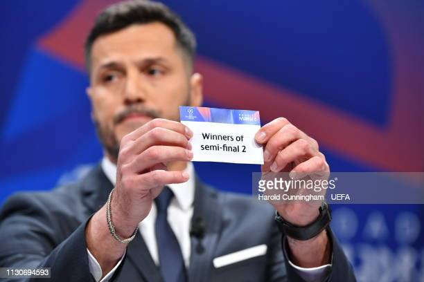 Champions League ambassador Julio Cesar draws out the card of 'Winners of semifinal 2' during the UEFA Champions League 2018/19 Quarterfinal...