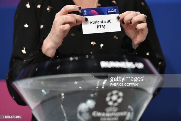 Champions League ambassador Kelly Smith holds the slip of Atalanta BC during the UEFA Champions League football cup round of 16 draw ceremony on...