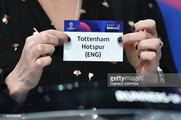 Champions League ambassador Kelly Smith holds the slip of Tottenham Hotspur during the UEFA Champions League football cup round of 16 draw ceremony...