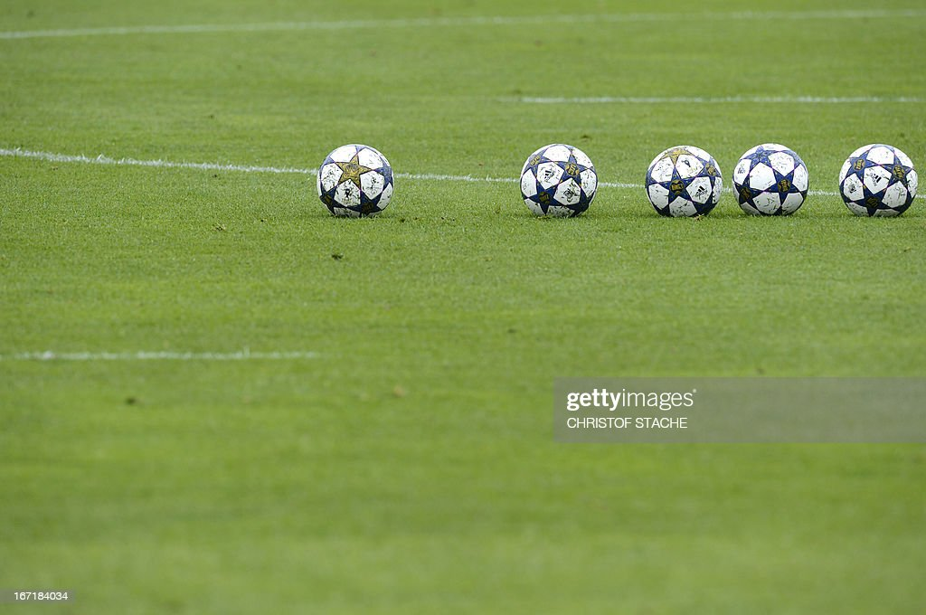Champions League balls are seen at the field during the final team training of FC Bayern Munich ahead the UEFA Champions League semi final first leg football match between FC Bayern Munich and FC Barcelona at the trainings area in Munich, southern Germany, on April 22, 2013. The semi final match will take place on Tuesday evening, April 23, 2013.