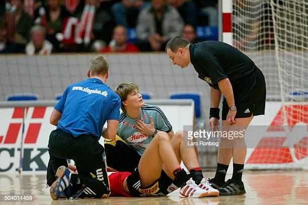 Champions League Bojana Petrovic Slagelse with an injury coach Anja Andersen talking to referee