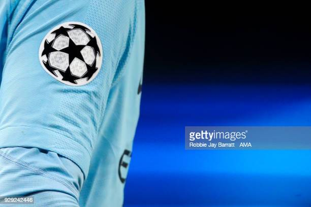 Champions League emblem branding is seen on the sleeve of Aymeric Laporte of Manchester City during the UEFA Champions League Round of 16 Second Leg...