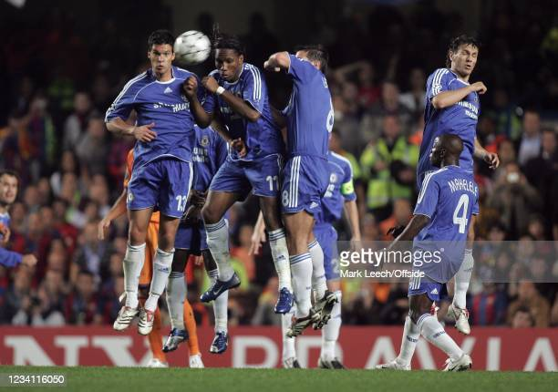 Champions League football, Chelsea v Barcelona, Michael Ballack, Didier Drogba and Frank Lampard of Chelsea jump to block the ball in Chelsea's...