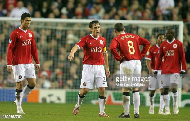 Champions League Football, Manchester United v Benfica, Cristiano Ronaldo of Manchester United watches as United captain Gary Neville tells Wayne...