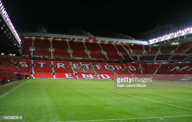Champions League Football, Manchester United v Benfica, General view of Old Trafford under floodlights looking towards the Stretford End.