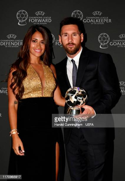 Champions League Forward of the Season 2018/19 Lionel Messi of FC Barcelona poses for a photo with his wife Antonella Roccuzzo following the UEFA...