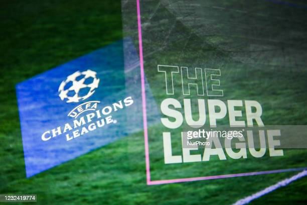 Champions League logo displayed on a phone screen and The Super League logo displayed on a screen are seen in this multiple exposure illustration...