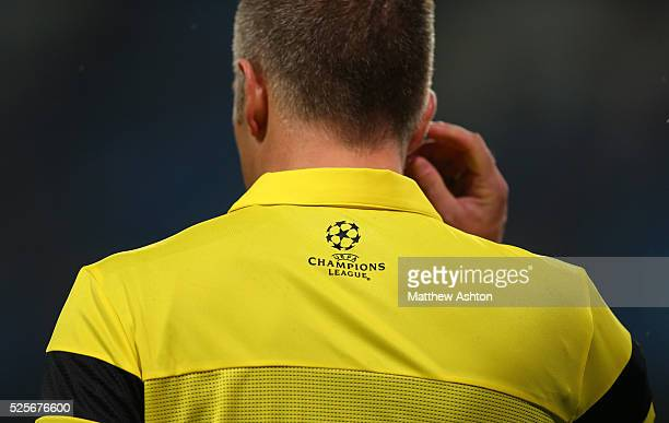 Champions League logo on the back of a yellow shirt of the assistant referee