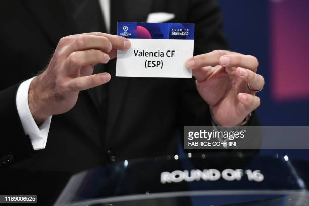 Champions League's ambassador Hamit Altintop holds the slip of Valencia CF during the UEFA Champions League football cup round of 16 draw ceremony on...