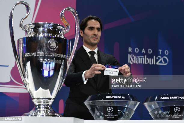 Champions League's ambassador Hamit Altintop holds the slip of Manchester City during the UEFA Champions League football cup round of 16 draw...