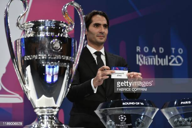 Champions League's ambassador Hamit Altintop holds the slip of Liverpool FC during the UEFA Champions League football cup round of 16 draw ceremony...