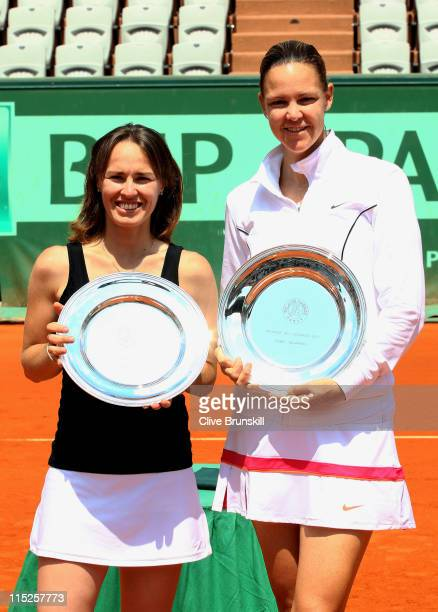 Champions Martina Hingis of Switzerland and Lindsay Davenport of USA pose with the trophies following their victory during the women's legends final...